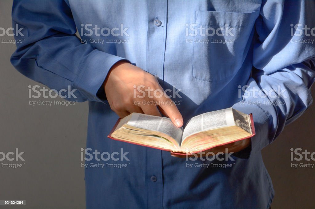 Man reading the Holy Bible. stock photo
