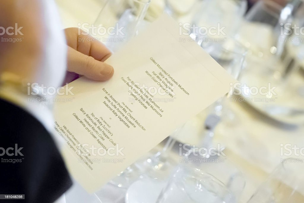 Man reading the menu at a wedding. royalty-free stock photo