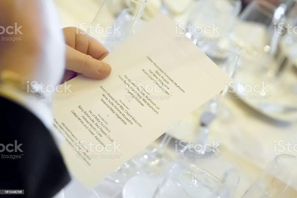 Man reading the menu at a wedding. stock photo