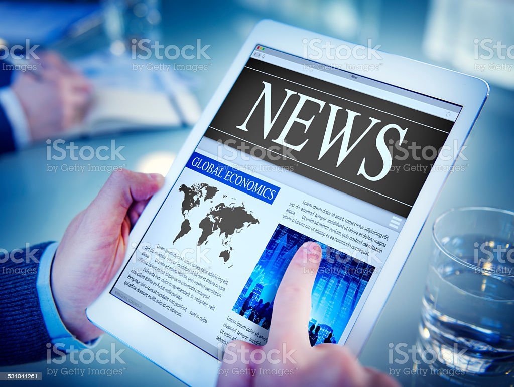 Man Reading the News on a Digital Tablet stock photo