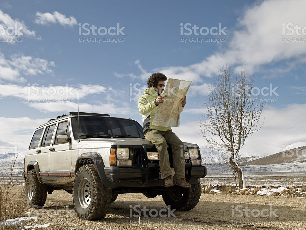 Man reading the road map royalty-free stock photo