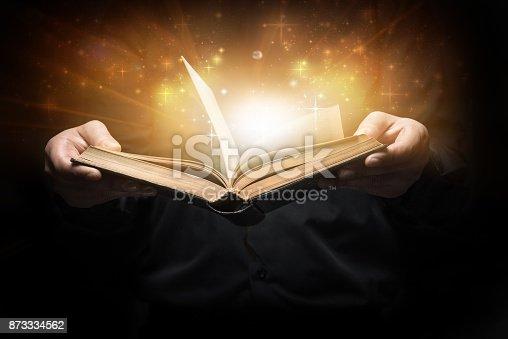 istock Man reads a book 873334562