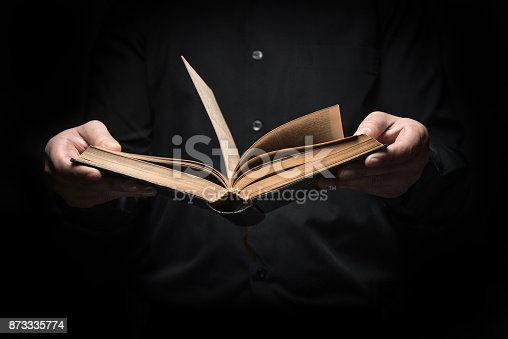 873333822istockphoto Man reads a book 873335774