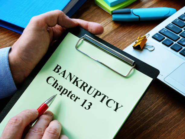 Man reads bankruptcy chapter 13 law in the office. stock photo