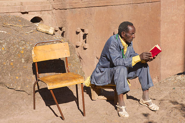Man reads book in Lalibela, Ethiopia stock photo