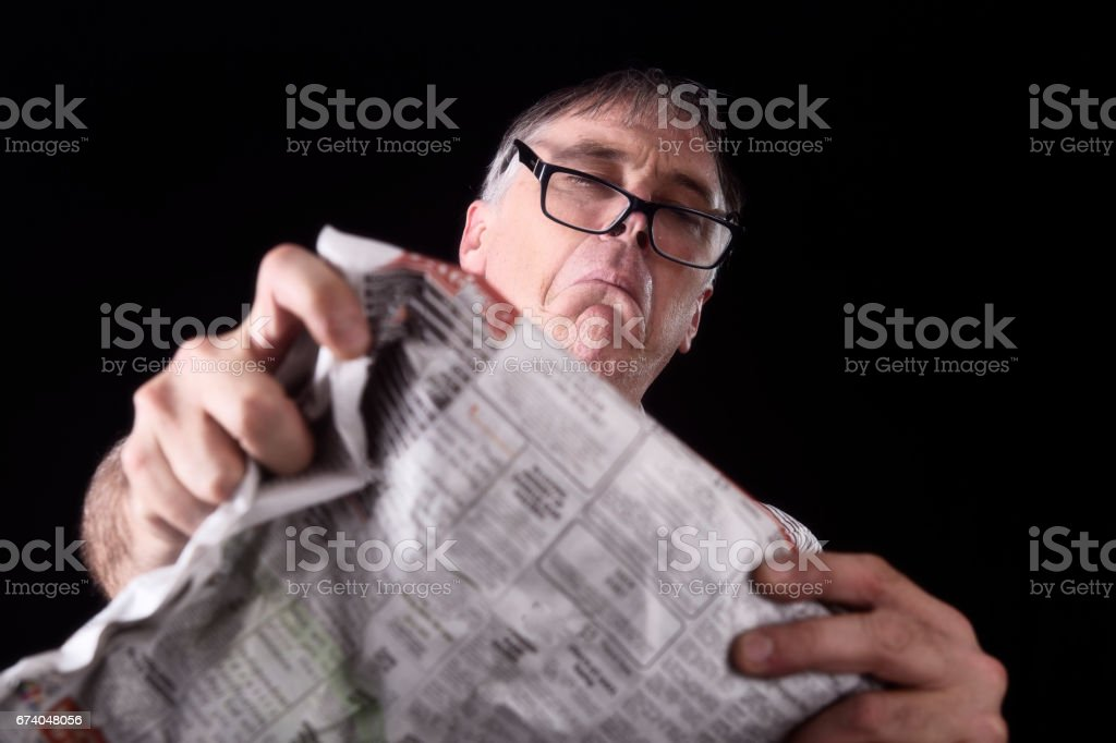 Man reads the classifieds in the newspaper royalty-free stock photo
