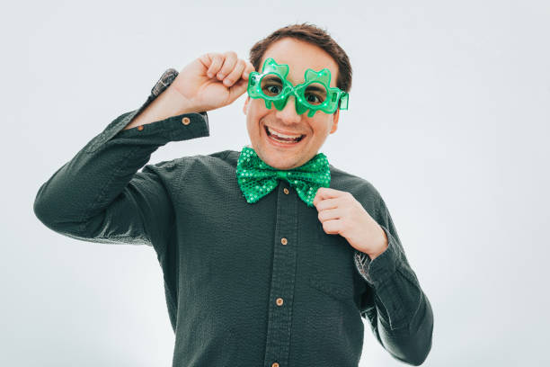 Man ready for St Patrick's Day Man ready for St Patrick's Day old man working in a pub stock pictures, royalty-free photos & images