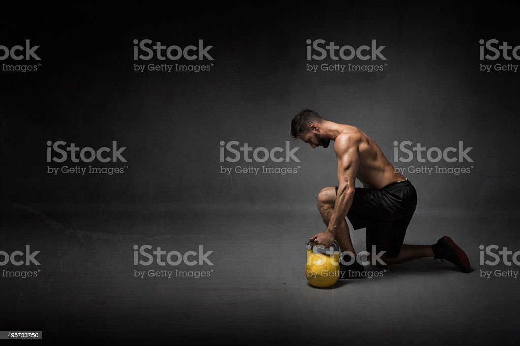 man ready to lifting a kettleball stock photo