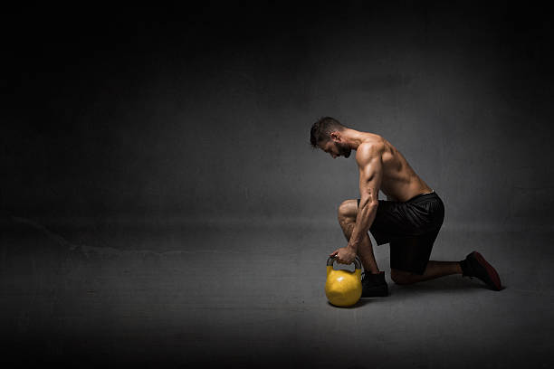 man ready to lifting a kettleball