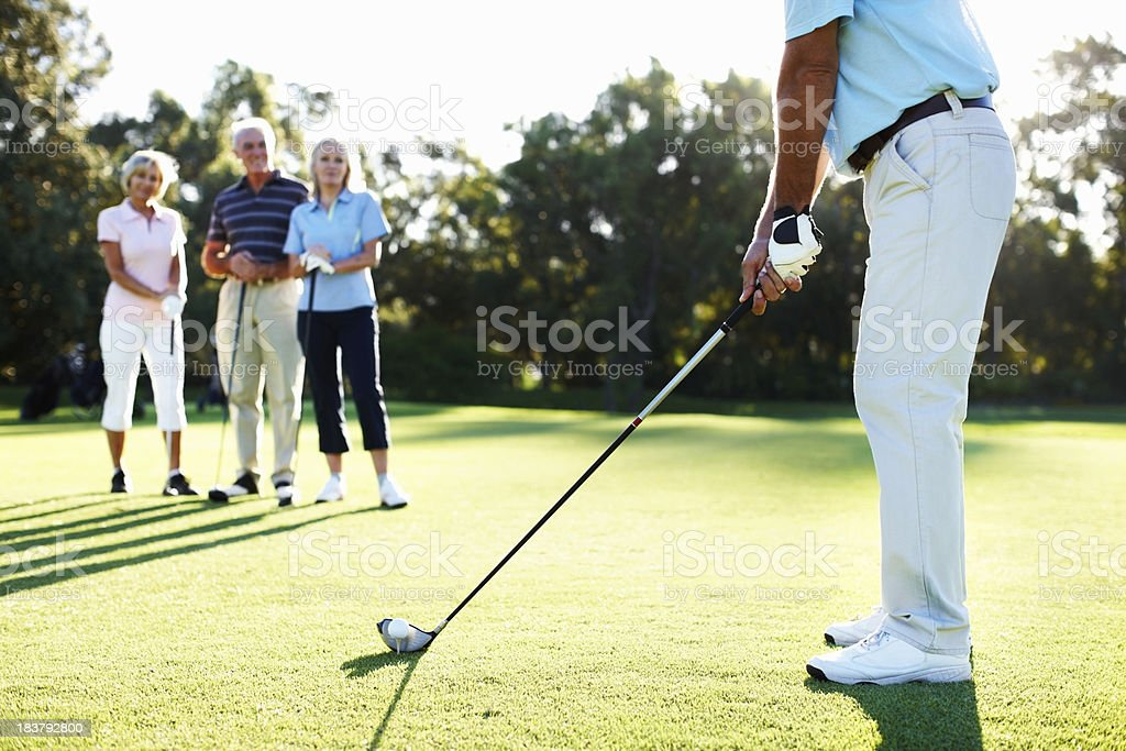 Man ready to tee off royalty-free stock photo