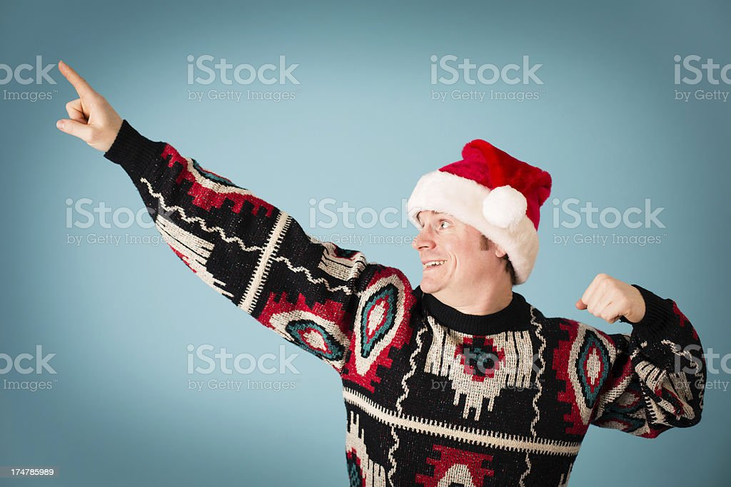 Man Rearing to Go, Wearing Santa Hat and Ugly Sweater stock photo
