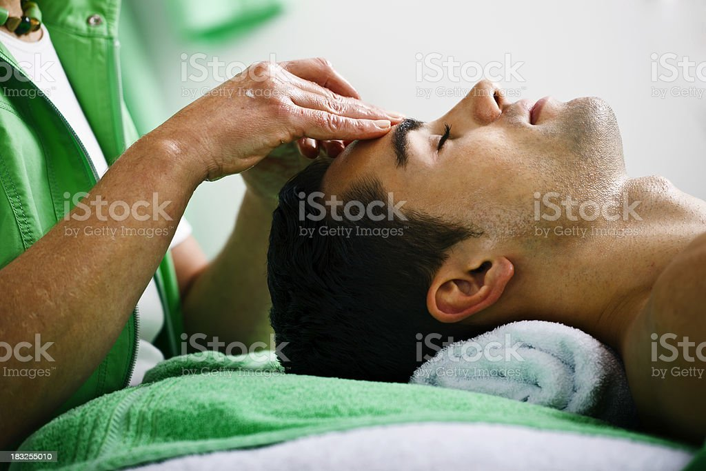 Man Receiving a Head Massage royalty-free stock photo