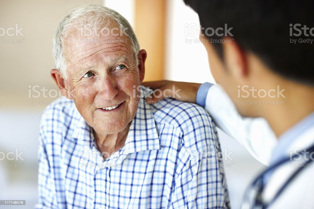 Man receiving advice from doctor stock photo