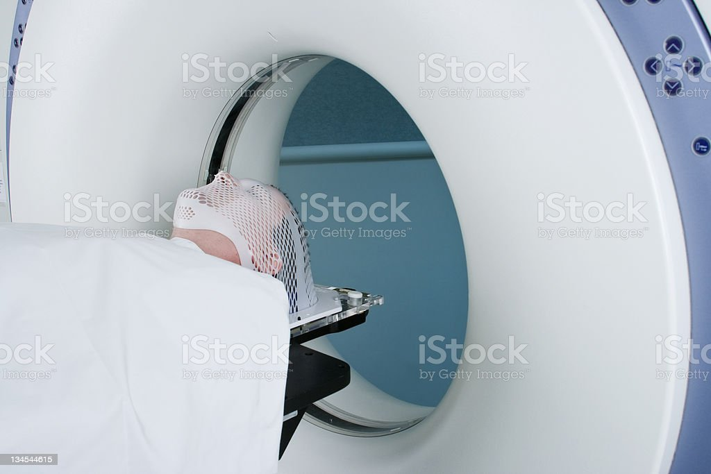 Man Receiving CAT Scan X-Ray of Head - Horizontal stock photo