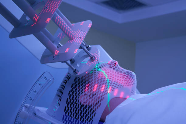 Man Receiving Electron Radiation (Radiotherapy) for Cancer Treatment stock photo