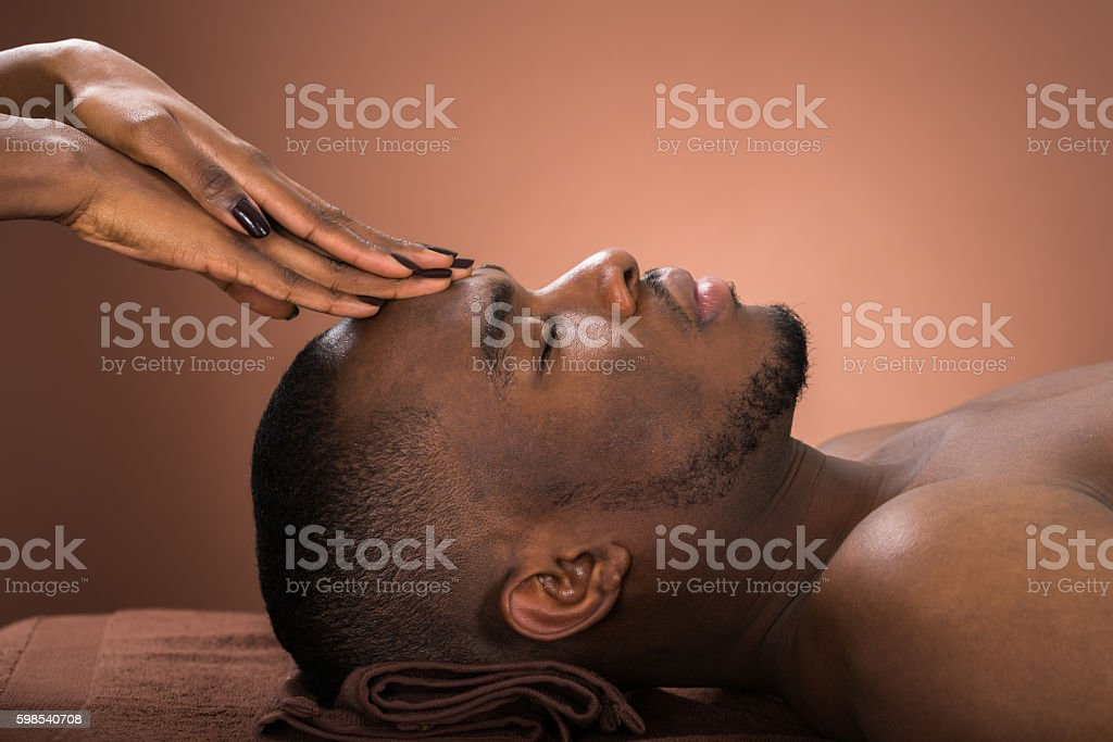 Man Receiving Forehead Massage stock photo