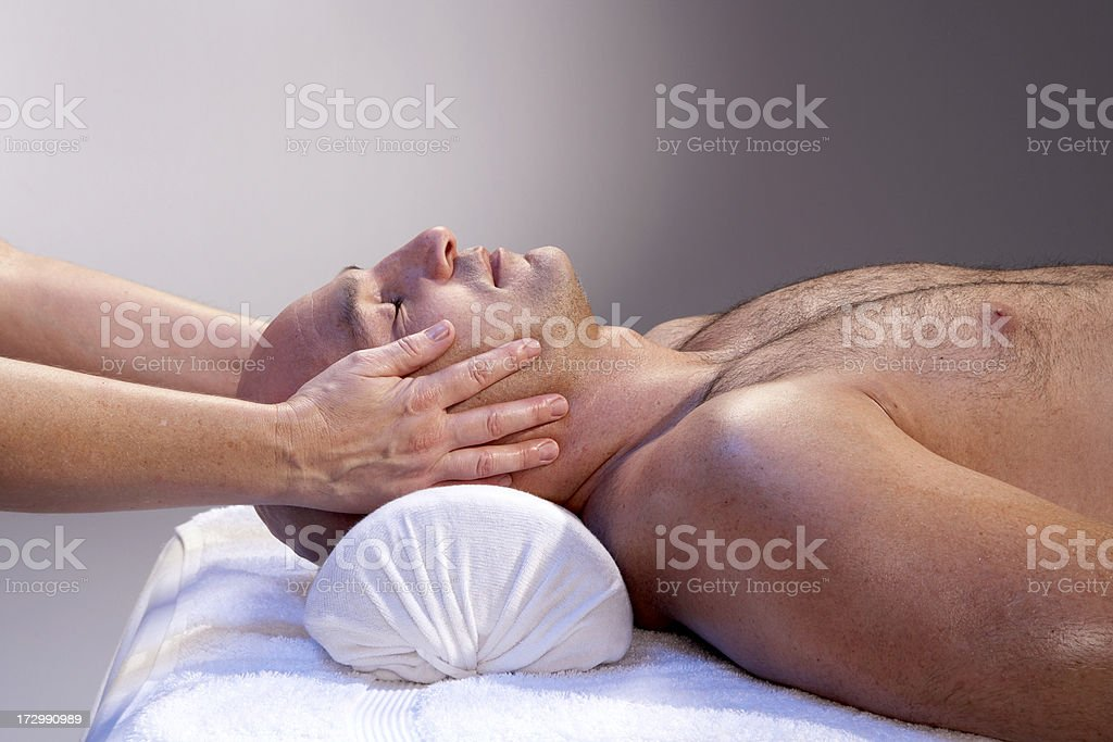 Man receiving head massage royalty-free stock photo