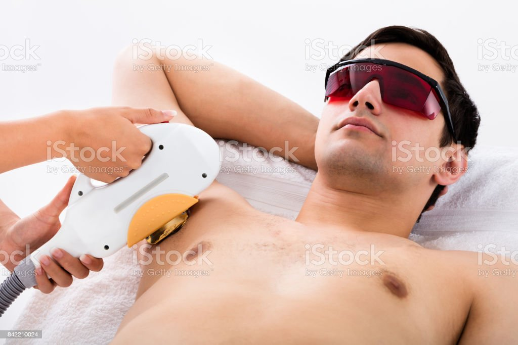 Man Receiving Laser Epilation Treatment On Underarms stock photo