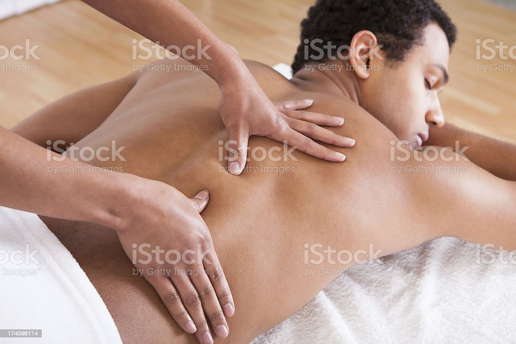 Man Receiving Massage From Female Hand stock photo
