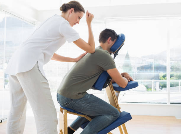 Man receiving massage from physiotherapist stock photo