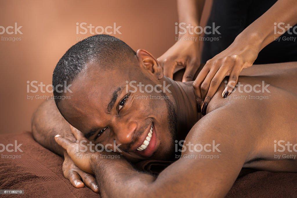 Man Receiving Massage Treatment stock photo