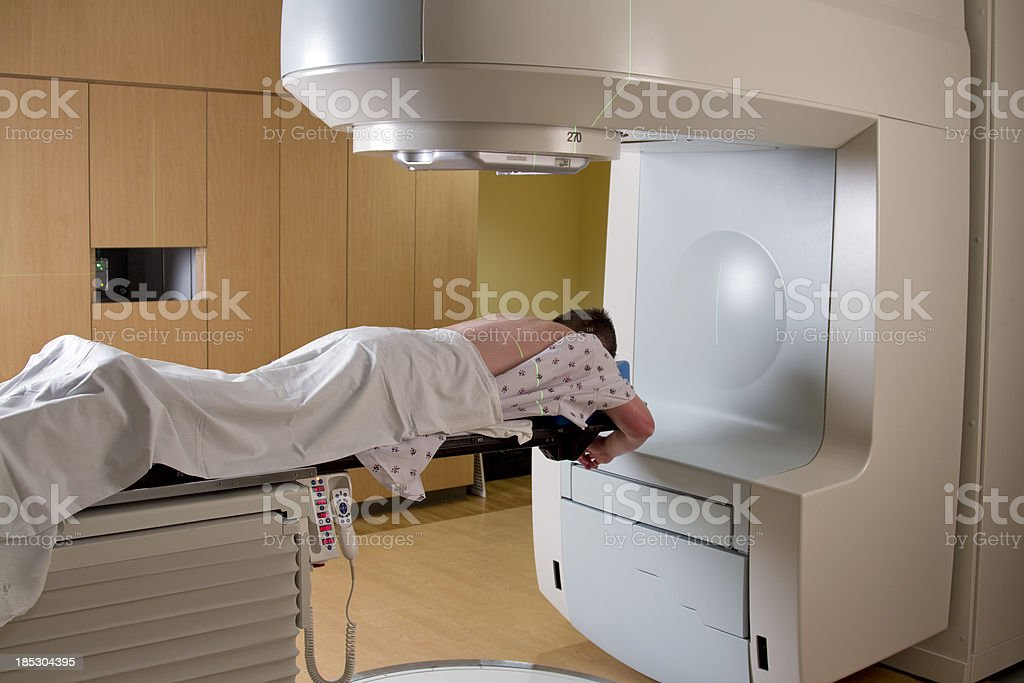 Man Receiving Radiation For Cancer Treatment stock photo