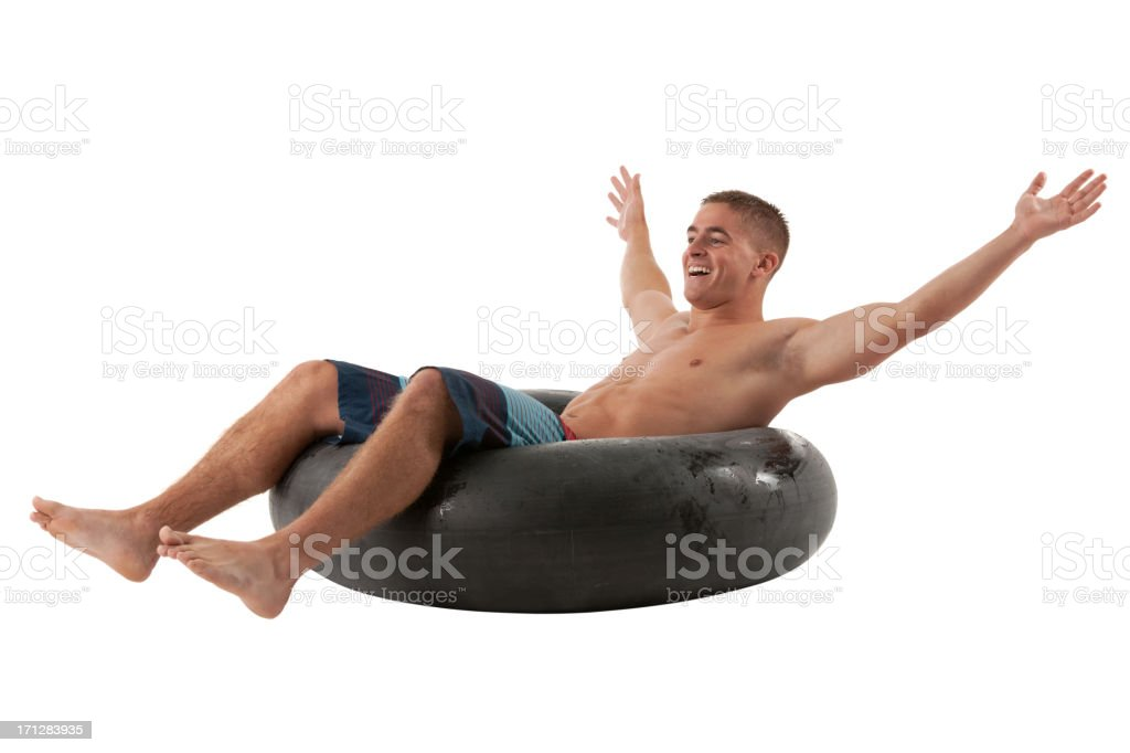 Man reclining in an inner tube royalty-free stock photo