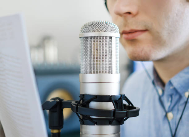 man recording an advertisement on the radio station. - radio dj stock photos and pictures