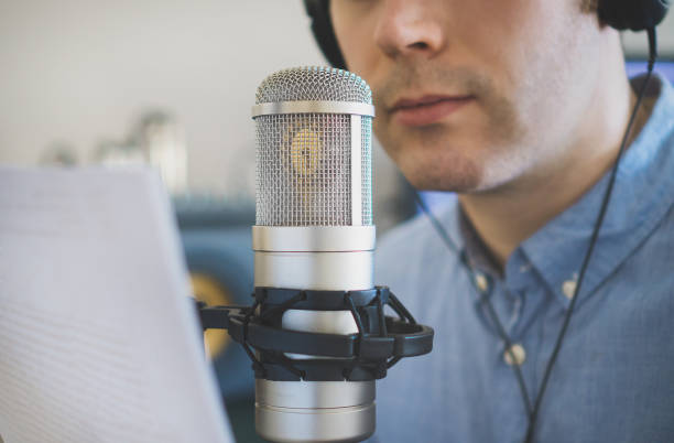 man recording an advertisement on the radio station. - trasmissione radiofonica foto e immagini stock