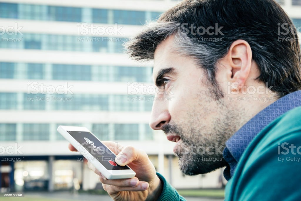 Man recording voice message stock photo