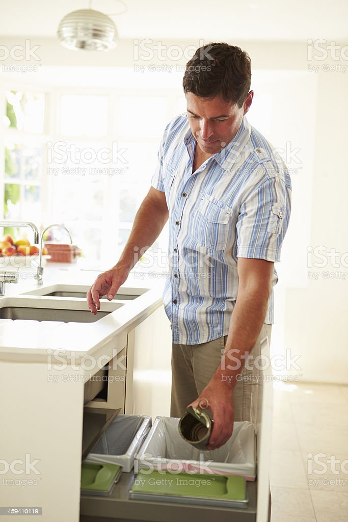 Man Recycling Kitchen Waste In Bin stock photo