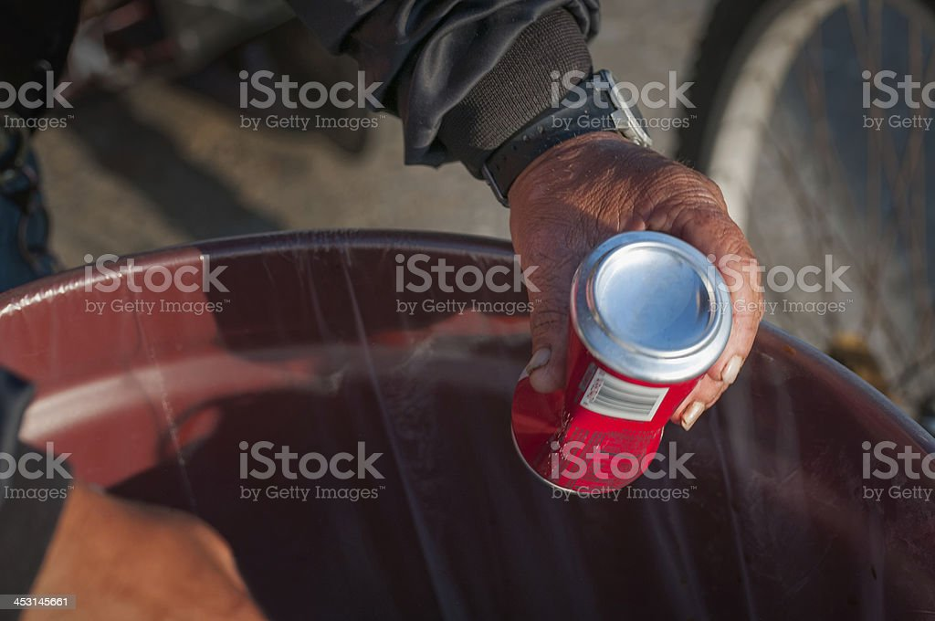 Man Recycling Soda Can stock photo