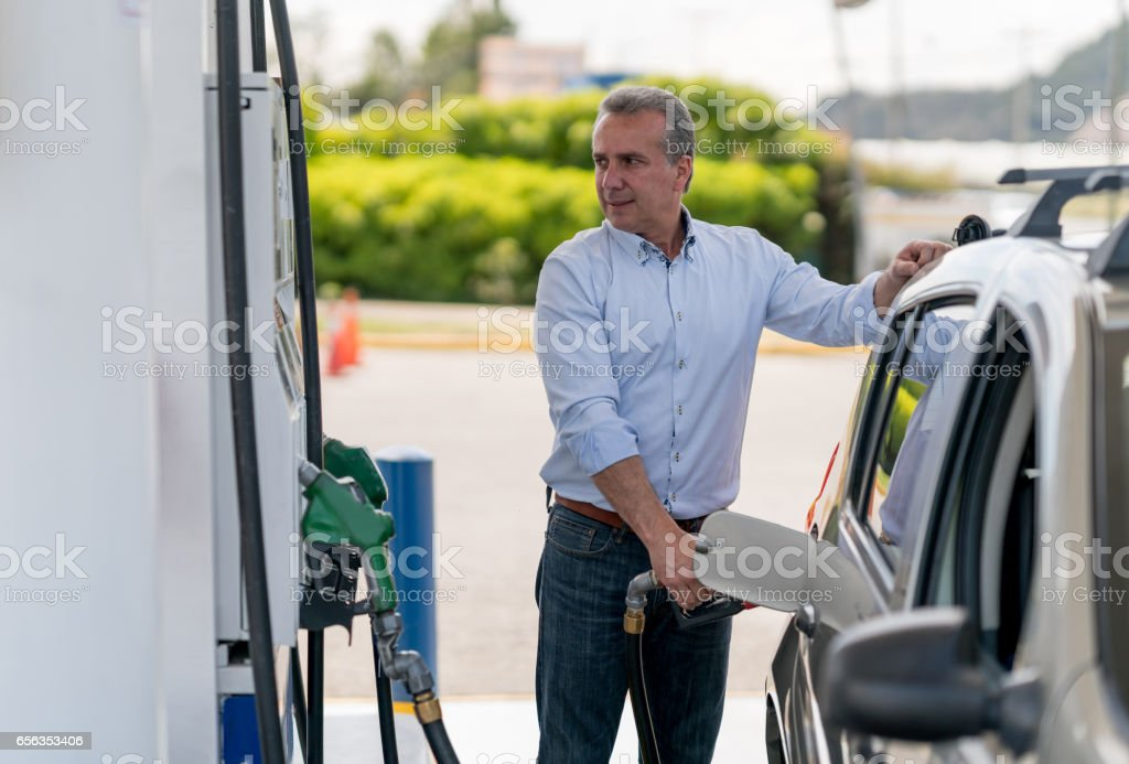 Man refueling his car at a gas station royalty-free stock photo