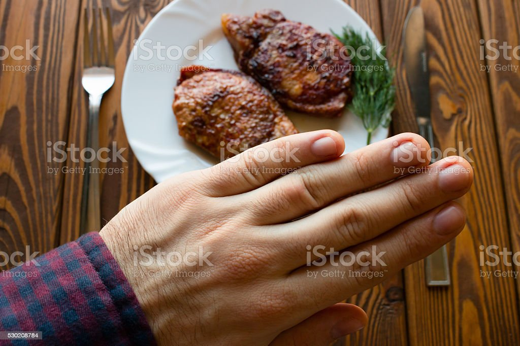 man refuses to grilled meat stock photo