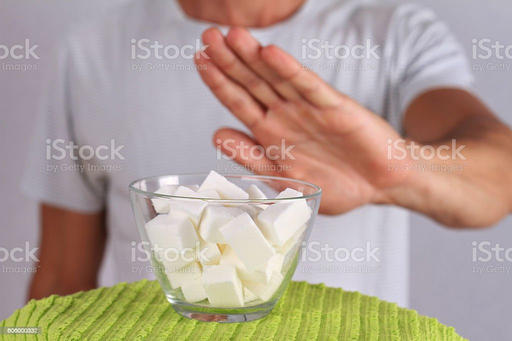 Man refuses white sugar. stock photo