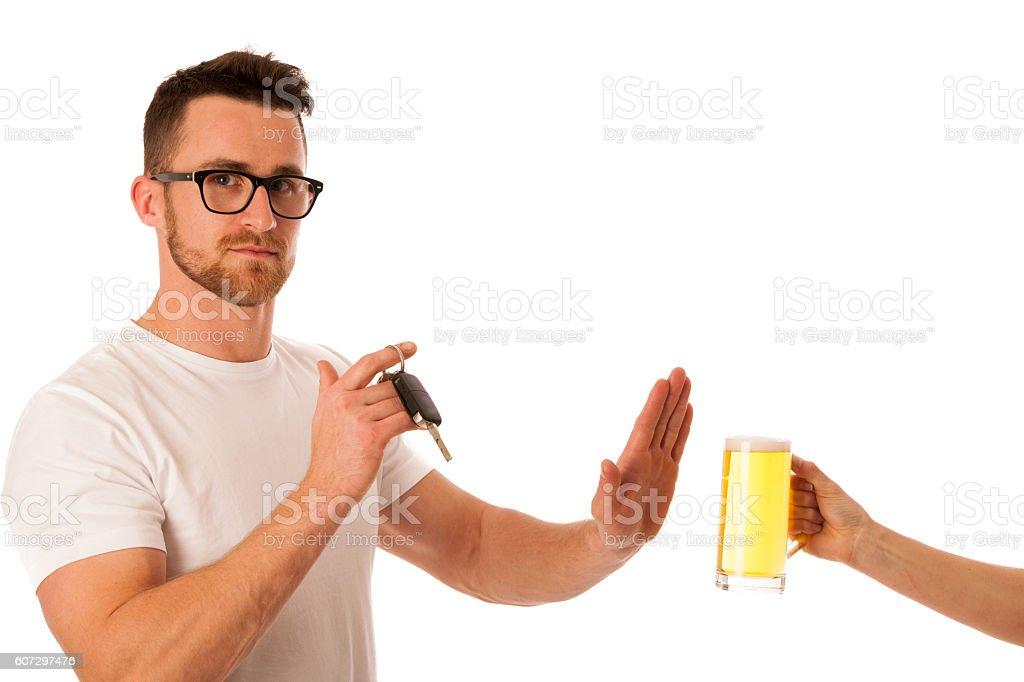 Man refusing alcohol beer showing car key as stock photo
