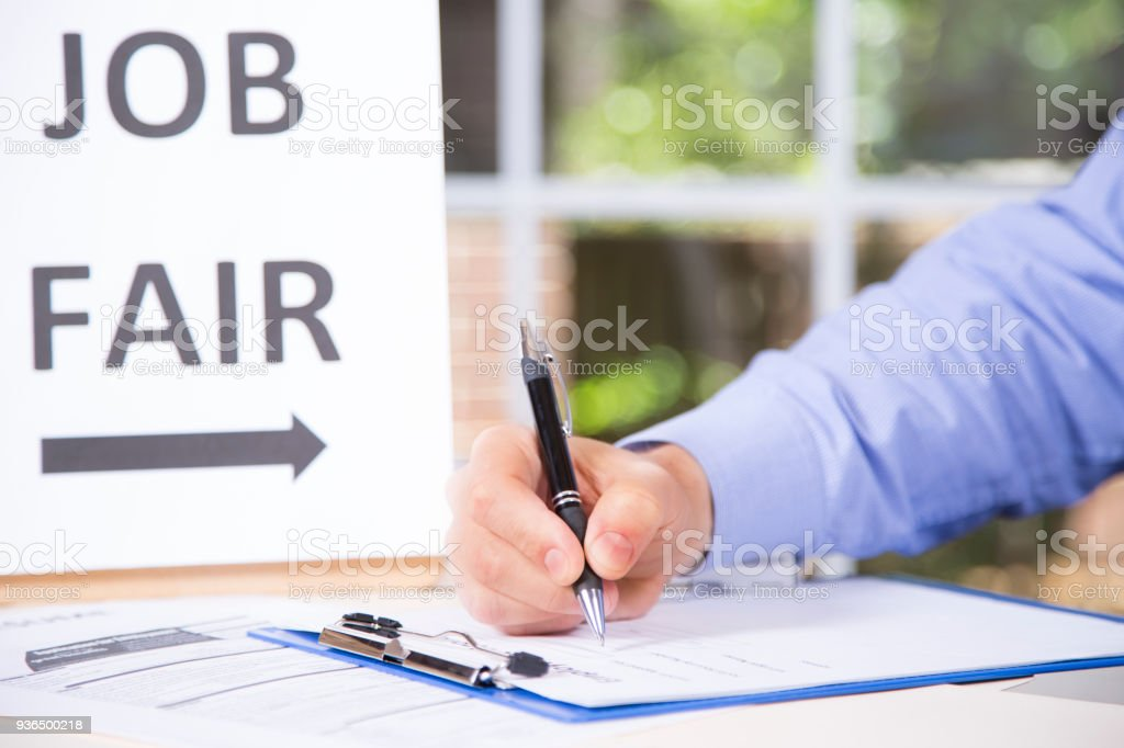 Man Registers At Job Fair With Employment Applications Resume Stock