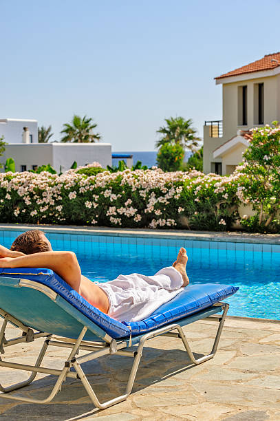 Man relax on deck chair stock photo