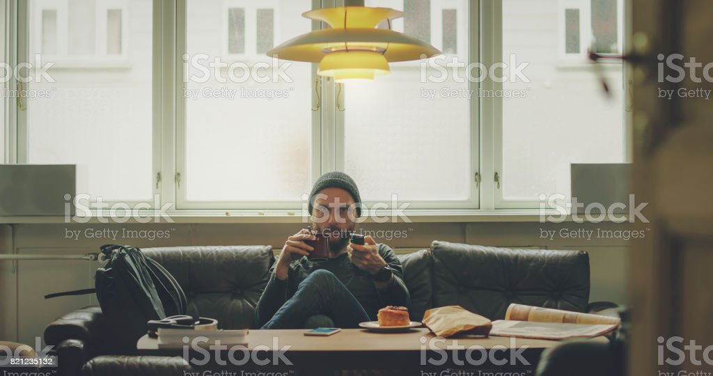 Man relaxed at home, takes a break stock photo