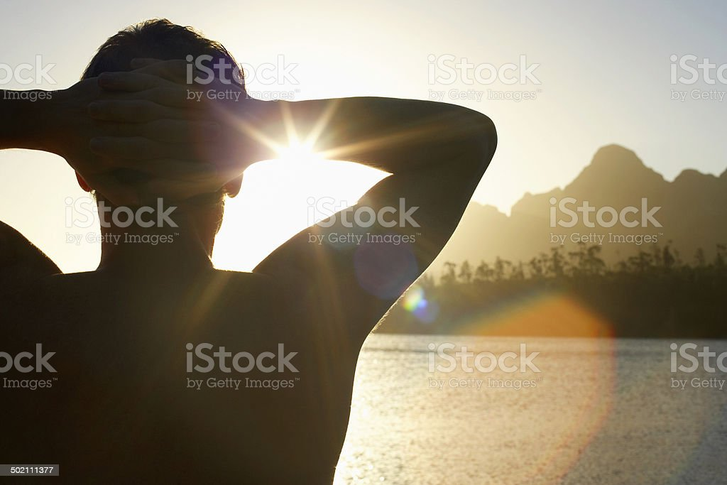 Man Relaxing By Lake stock photo