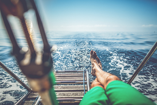 Man Relaxing During Cruise On A Sailing Boat Stock Photo - Download Image Now