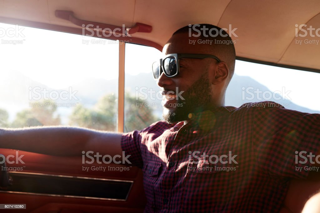 Man Relaxing In Car During Road Trip stock photo