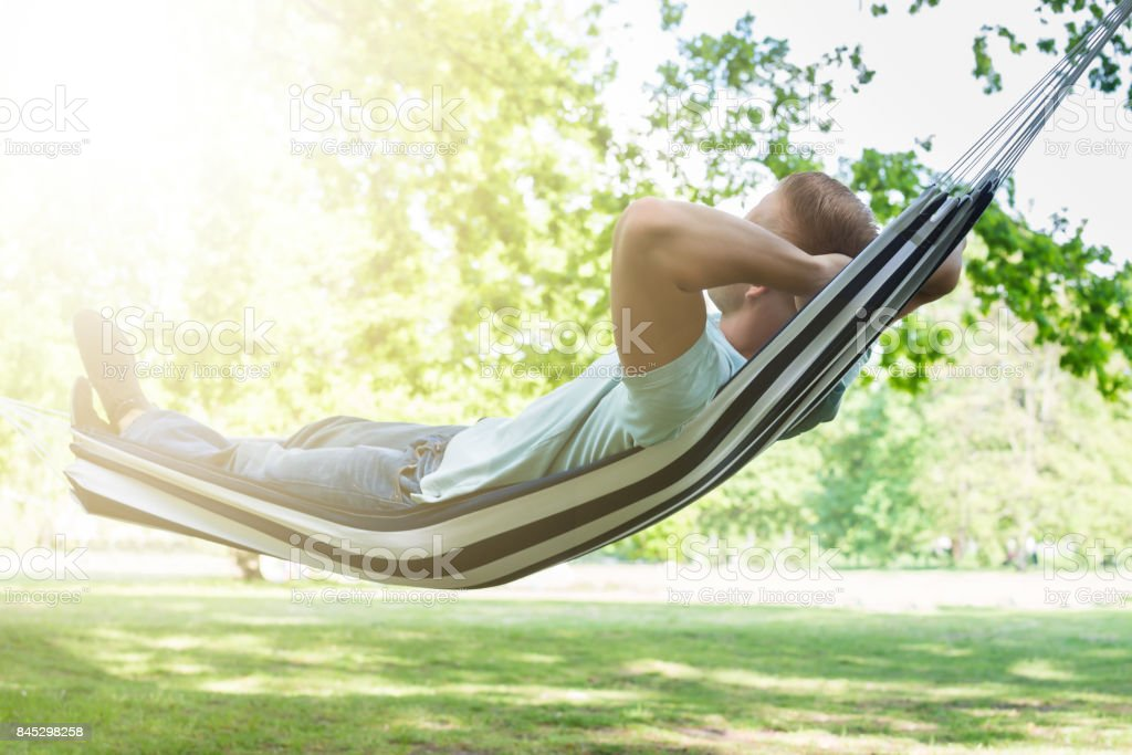 Man Relaxing In Hammock stock photo