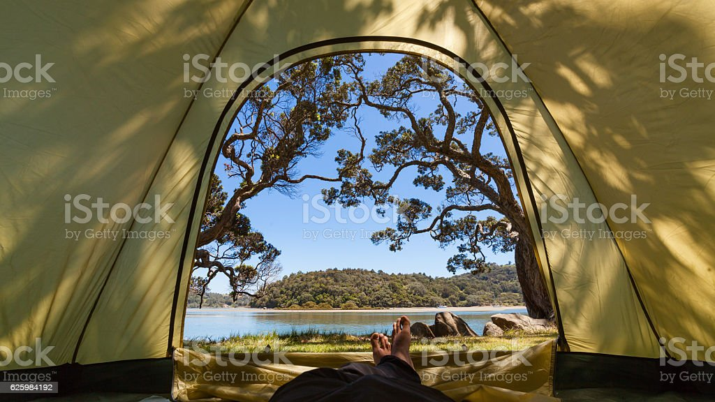 Man Relaxing in Tent. stock photo