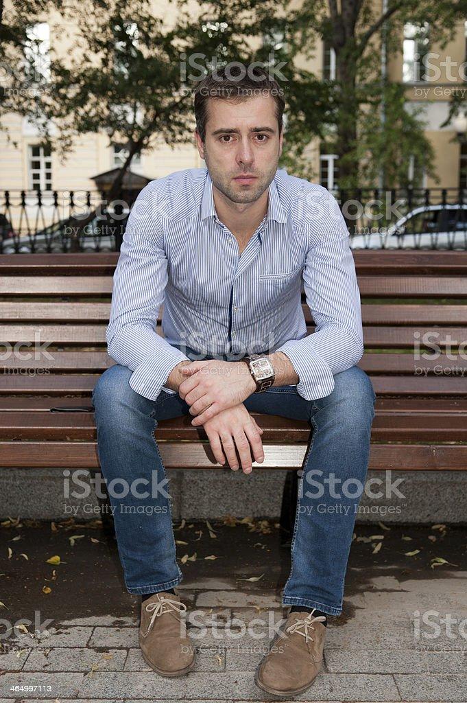 Man relaxing in the public garden stock photo