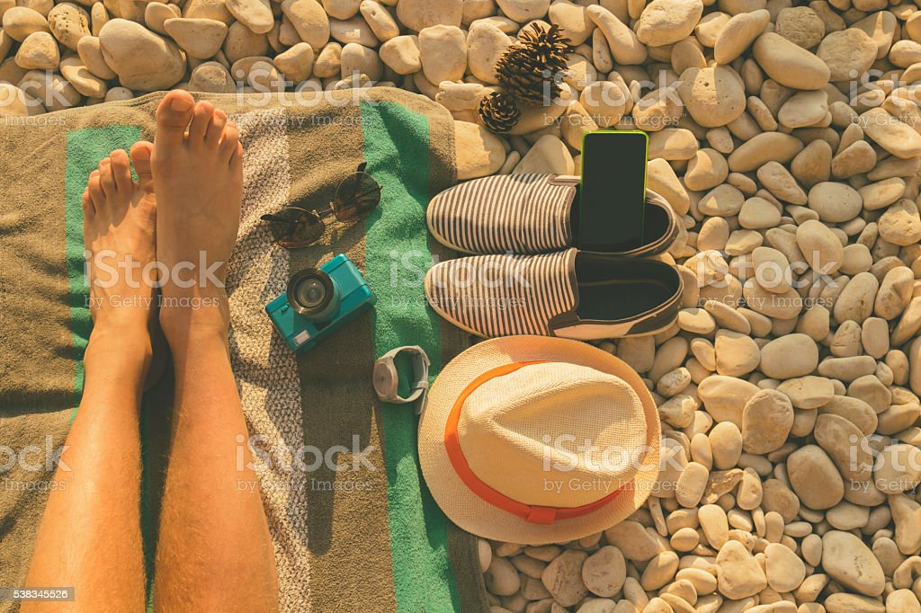 Man relaxing on the beach. stock photo