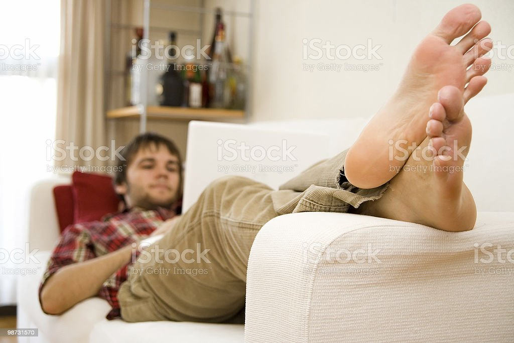 Man relaxing on the sofa 免版稅 stock photo