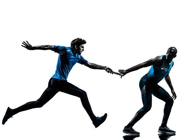 mann relay runner sprinter silhouette - staffelstab stock-fotos und bilder
