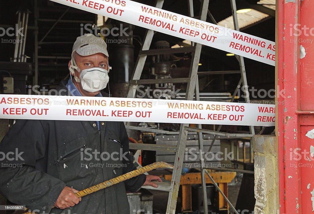 man removing asbestos stock photo