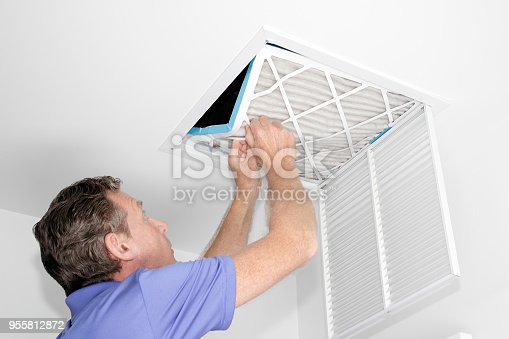istock Man Removing Dirty Air Filter 955812872